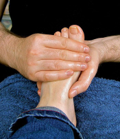 Massage is a great way to get rid of excess fluid around the feet