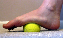 Use a tennis ball or golf ball to massage and stretch the plantar fascia - a great way to relieve foot pain.  Approved use www.hep2go.com