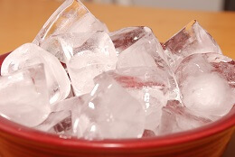 Regularly applying ice can help to reduce pain and inflammation with heel bursitis